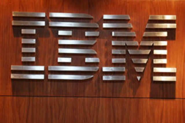 IBM reported a second-quarter profit that beat analyst estimates and raised its full-year outlook on the growth from its software and outsourcing segment.