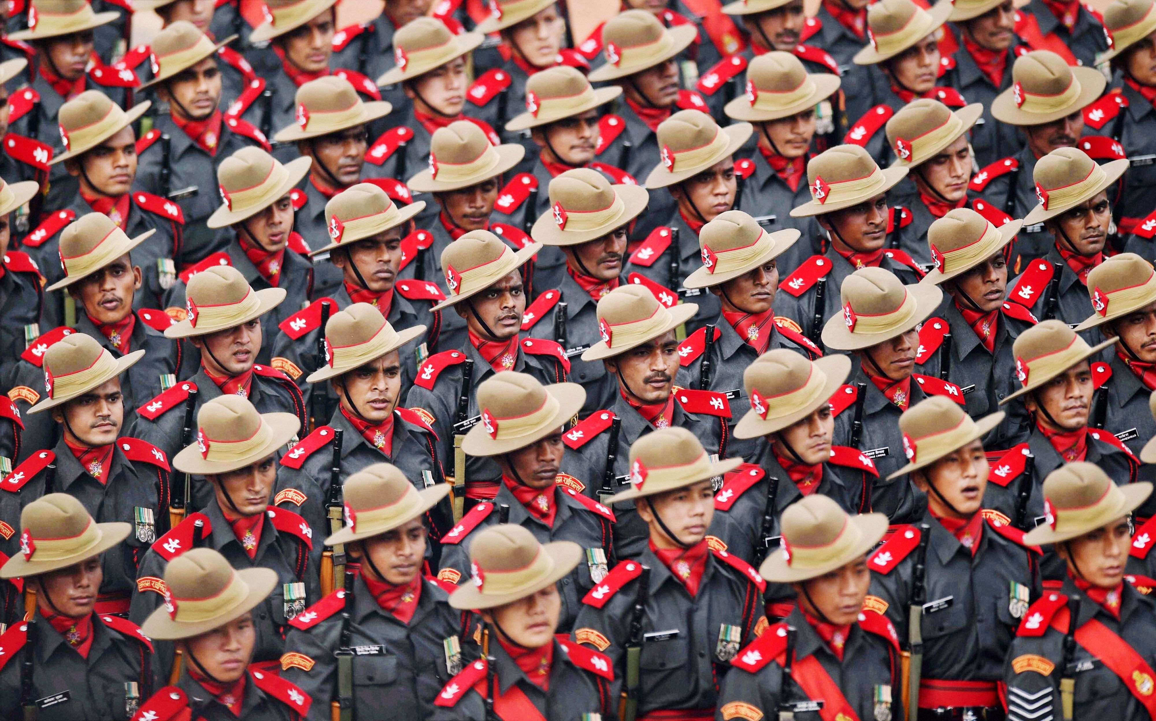 Paramilitary soldiers march during the full dress rehearsal for the Republic Day parade at Rajpath in New Delhi. (PTI photo by Atul Yadav)
