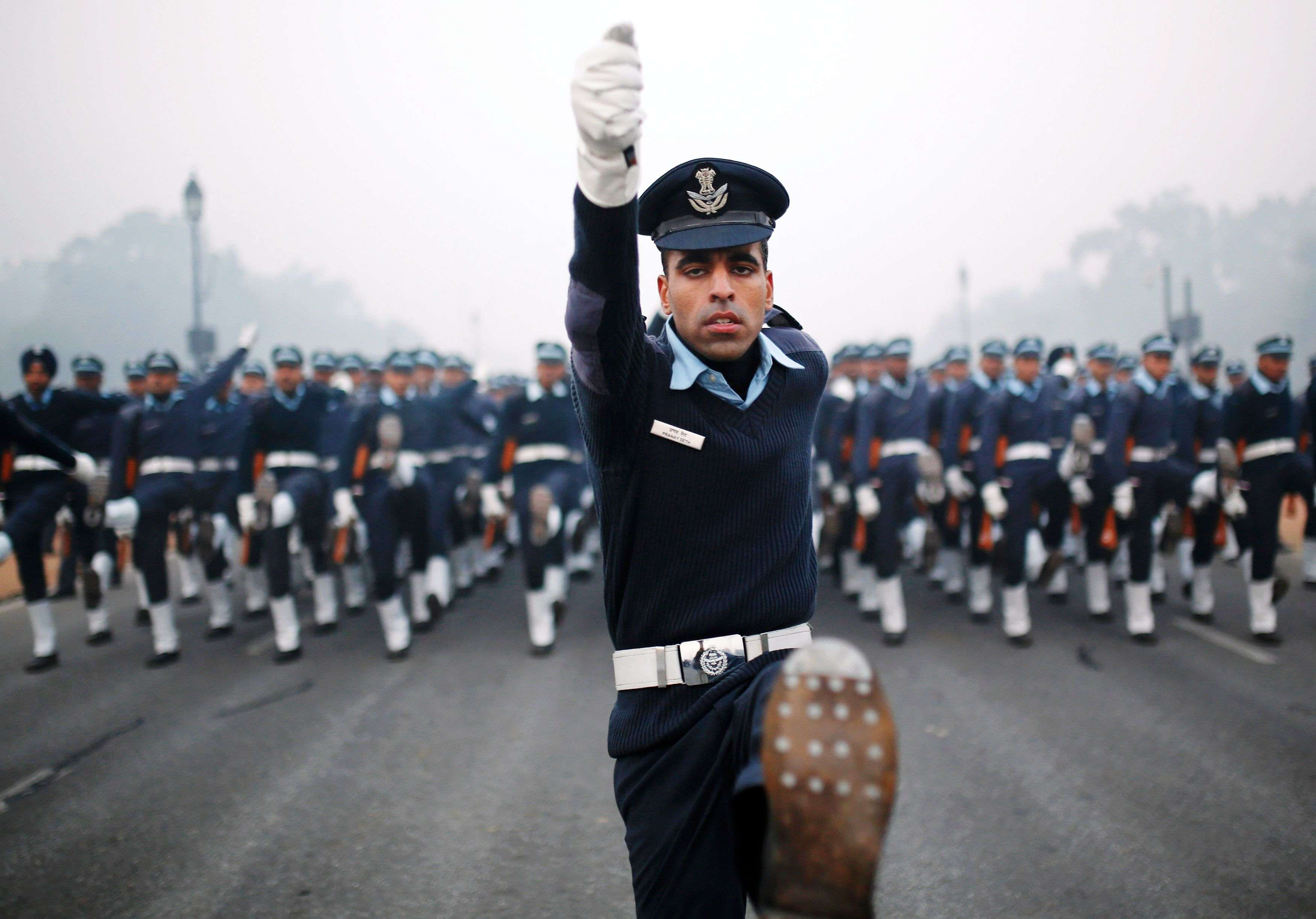Indian Air Force soldiers rehearse for the Republic Day parade on a cold and foggy winter morning in New Delhi. (REUTERS/Ahmad Masood)