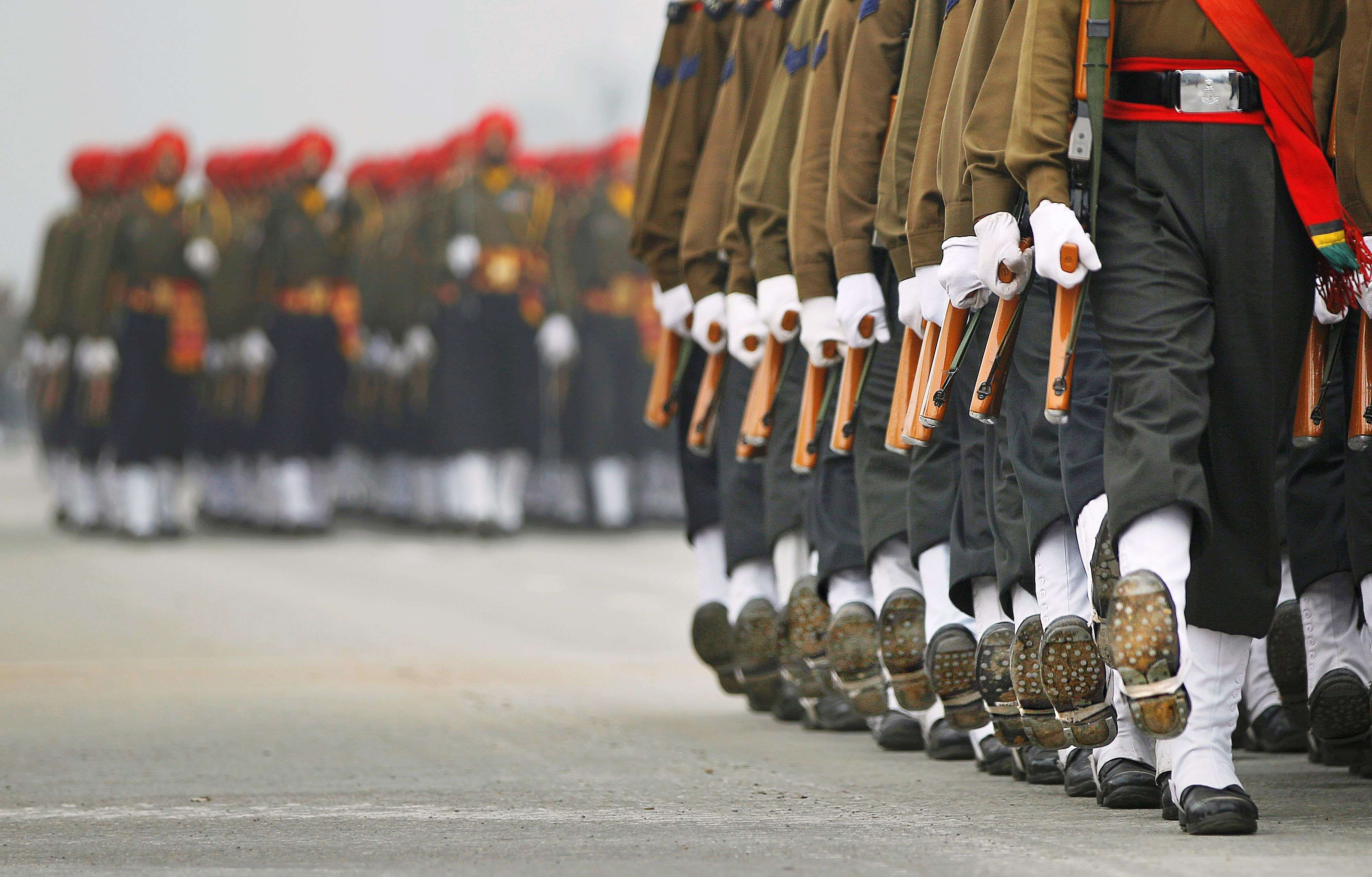 Paramilitary soldiers march during rehearsals for the upcoming Republic Day parade in New Delhi. (AP Photo/Altaf Qadri)