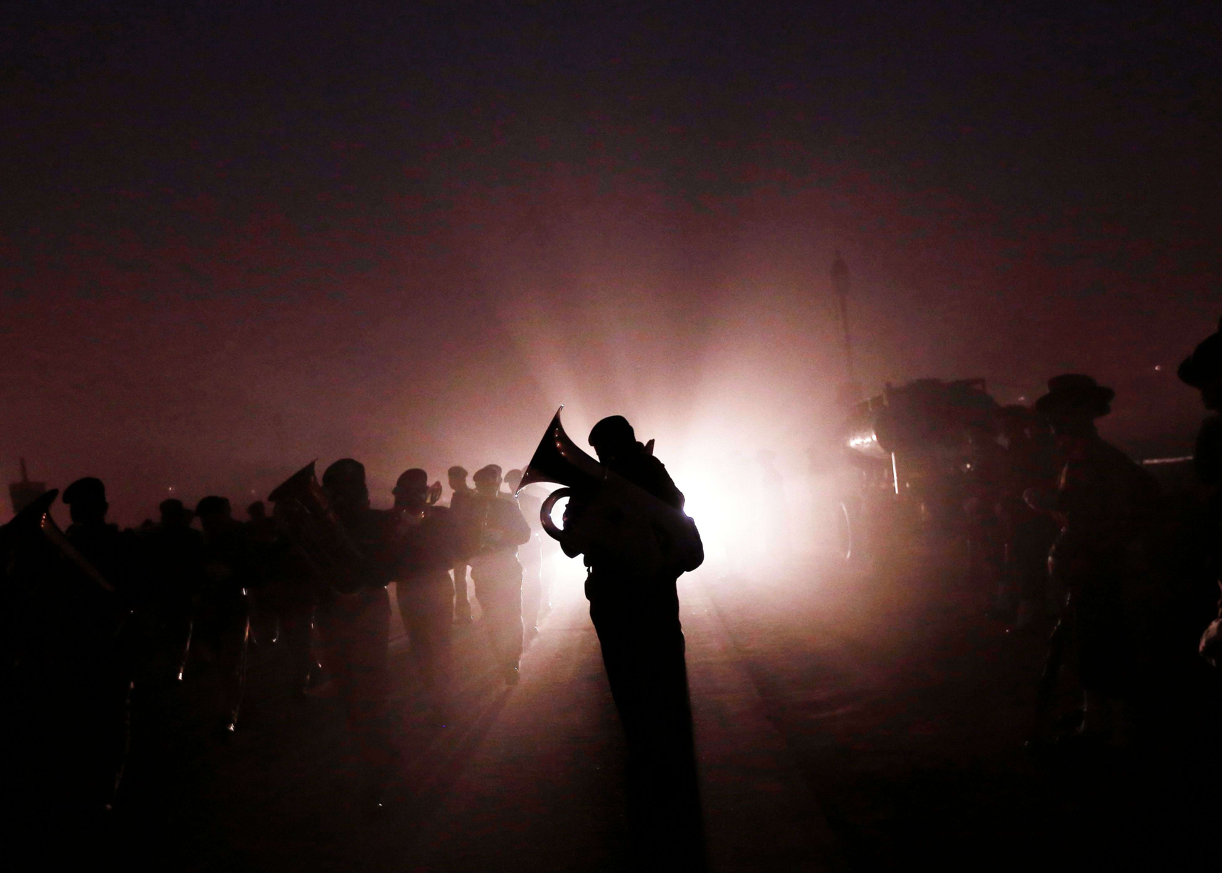Band members of security forces rehearse for the Republic Day parade on a foggy winter morning in New Delhi. (REUTERS/Adnan Abidi)