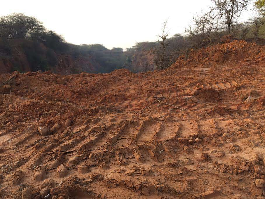 As can be seen, bulldozers have been used to carve out a path where none existed.