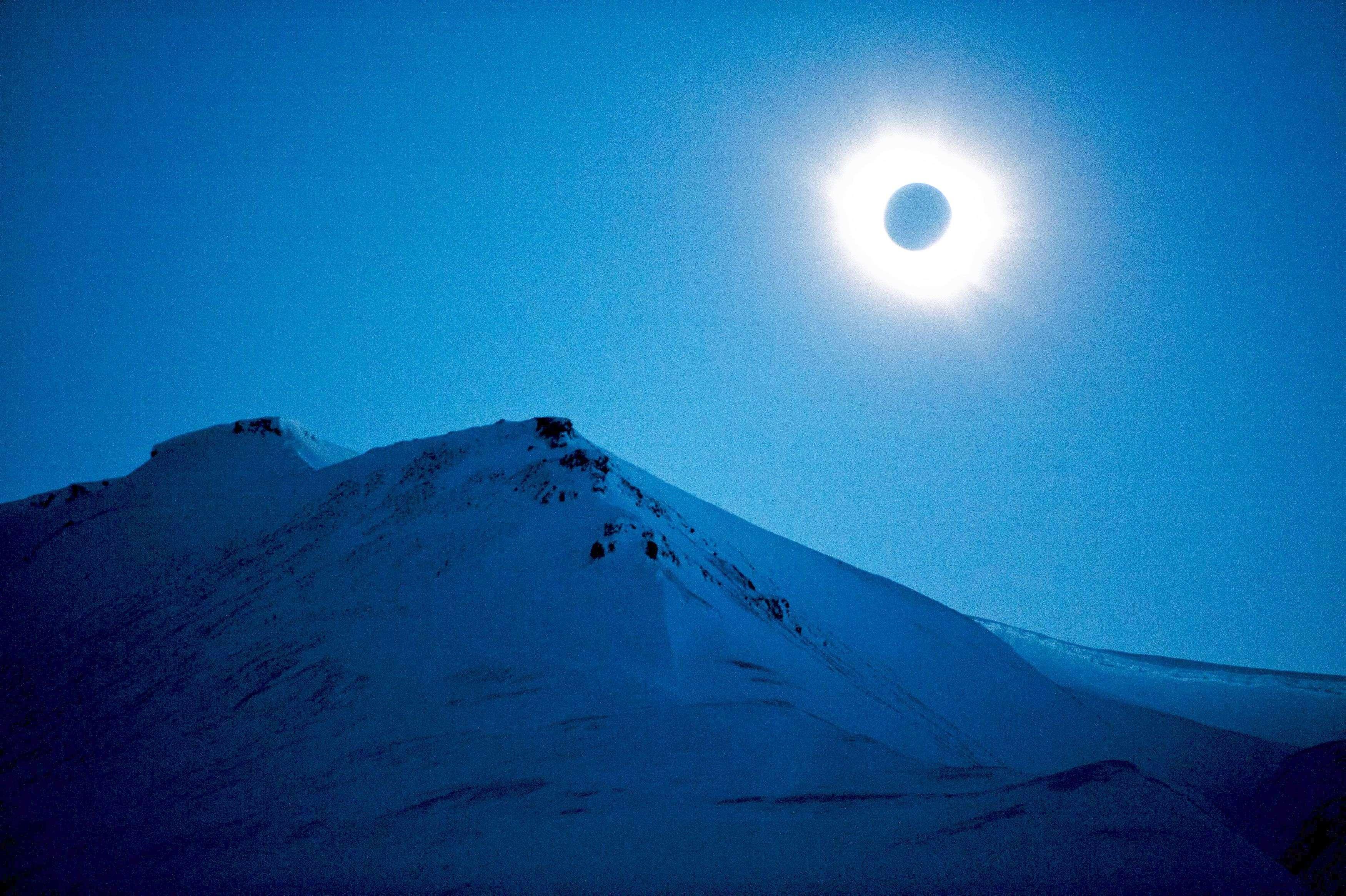 A total solar eclipse is seen in Longyearbyen on Svalbard. (REUTERS/Jon Olav Nesvold)