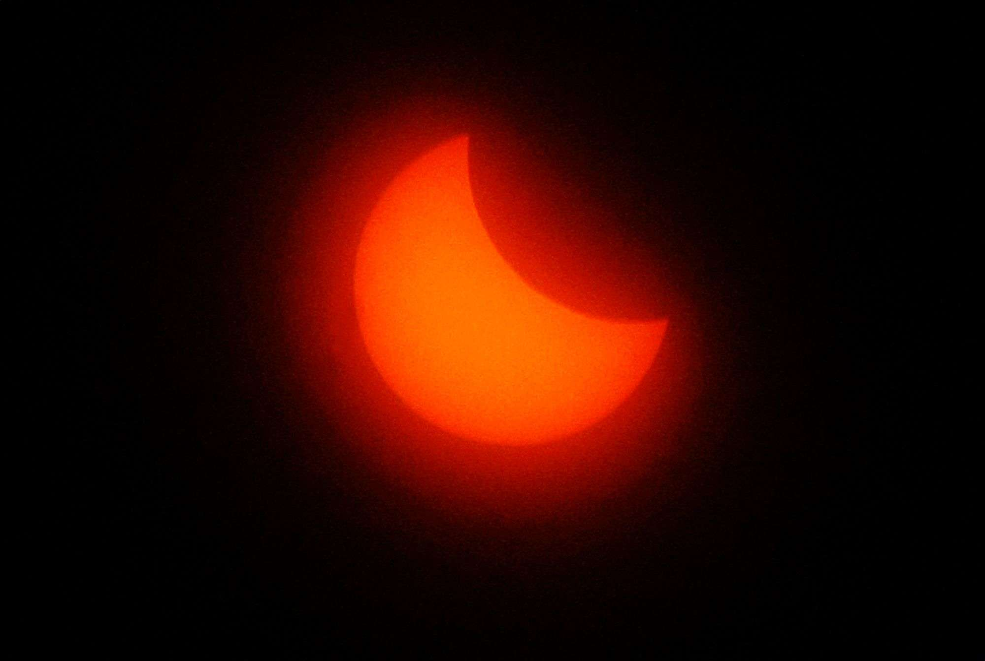 The sun is seen during a solar eclipse in Marseille, southern France. (AP Photo/Claude Paris)