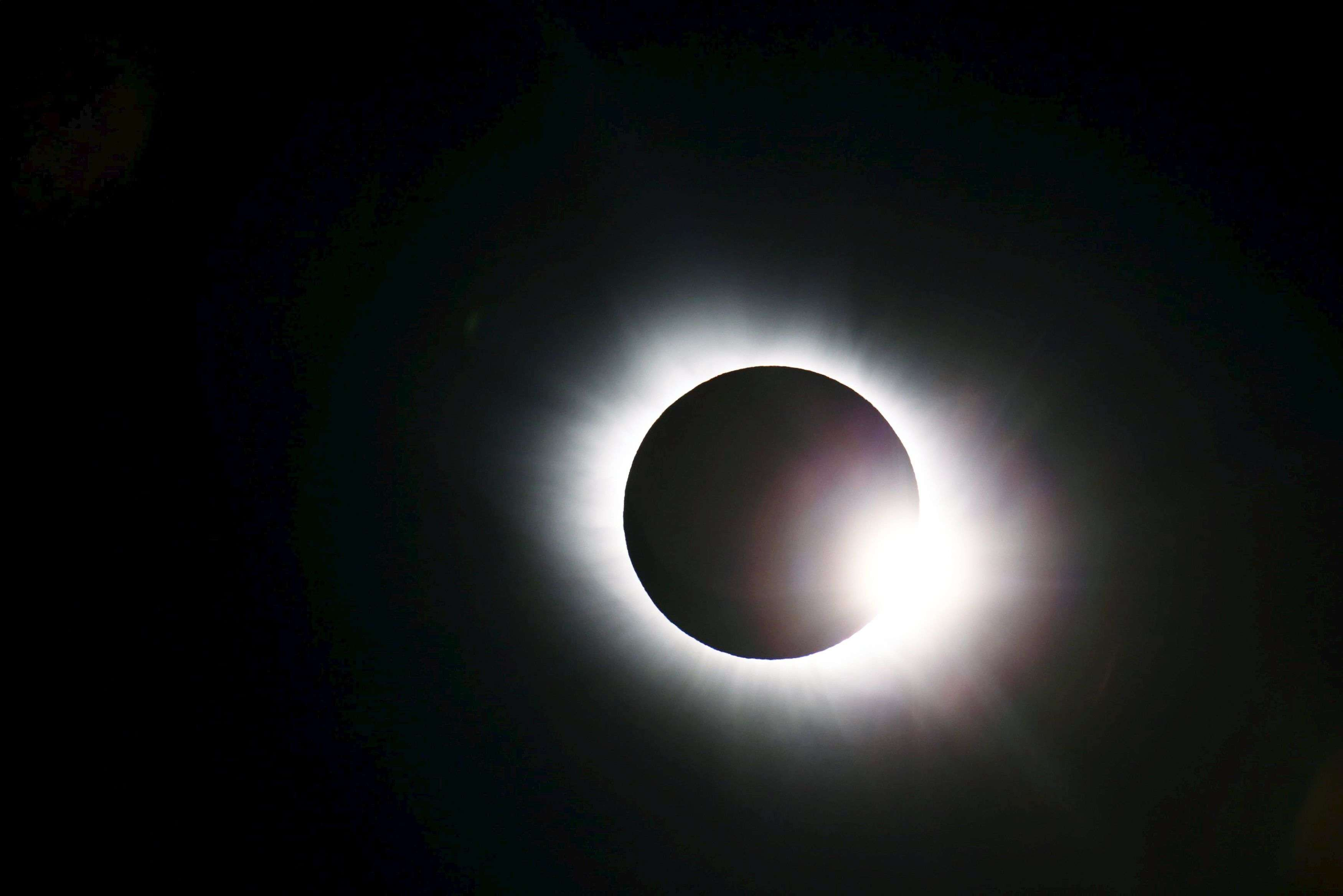 A partial eclipse was visible on Friday, the first day of northern spring, across parts of Africa, Europe and Asia. The total eclipse of the sun was only visible in the Faroe Islands and the Norwegian archipelago of Svalbard in the Arctic Ocean. (REUTERS/Haakon Mosvold Larsen)