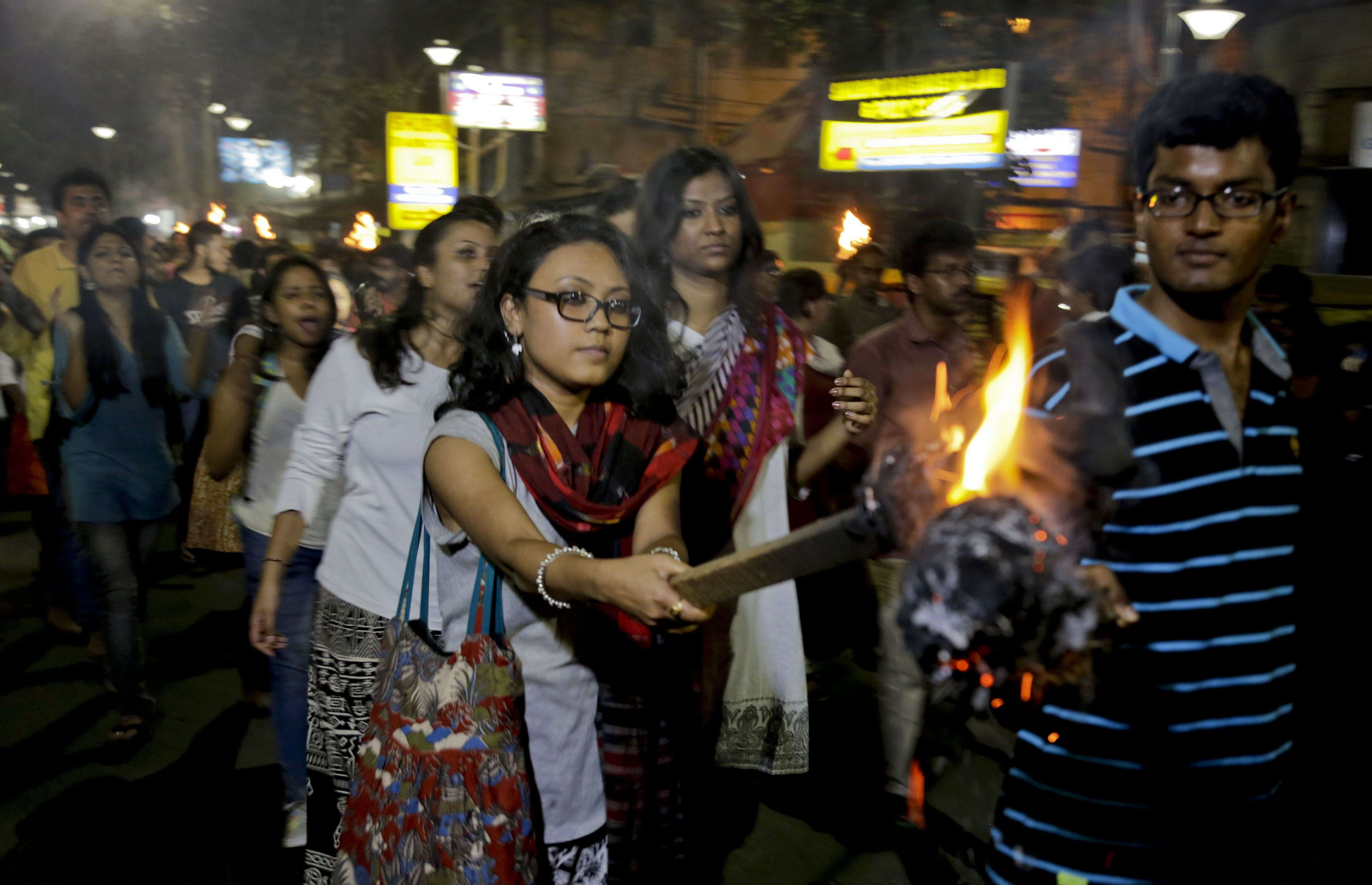 Students of Jadavpur University march in a torch light procession protesting against the arrest of a student union leader of New Delhi's Jawaharlal Nehru University in Kolkata. (Picture courtesy: AP Photo/ Bikas Das)