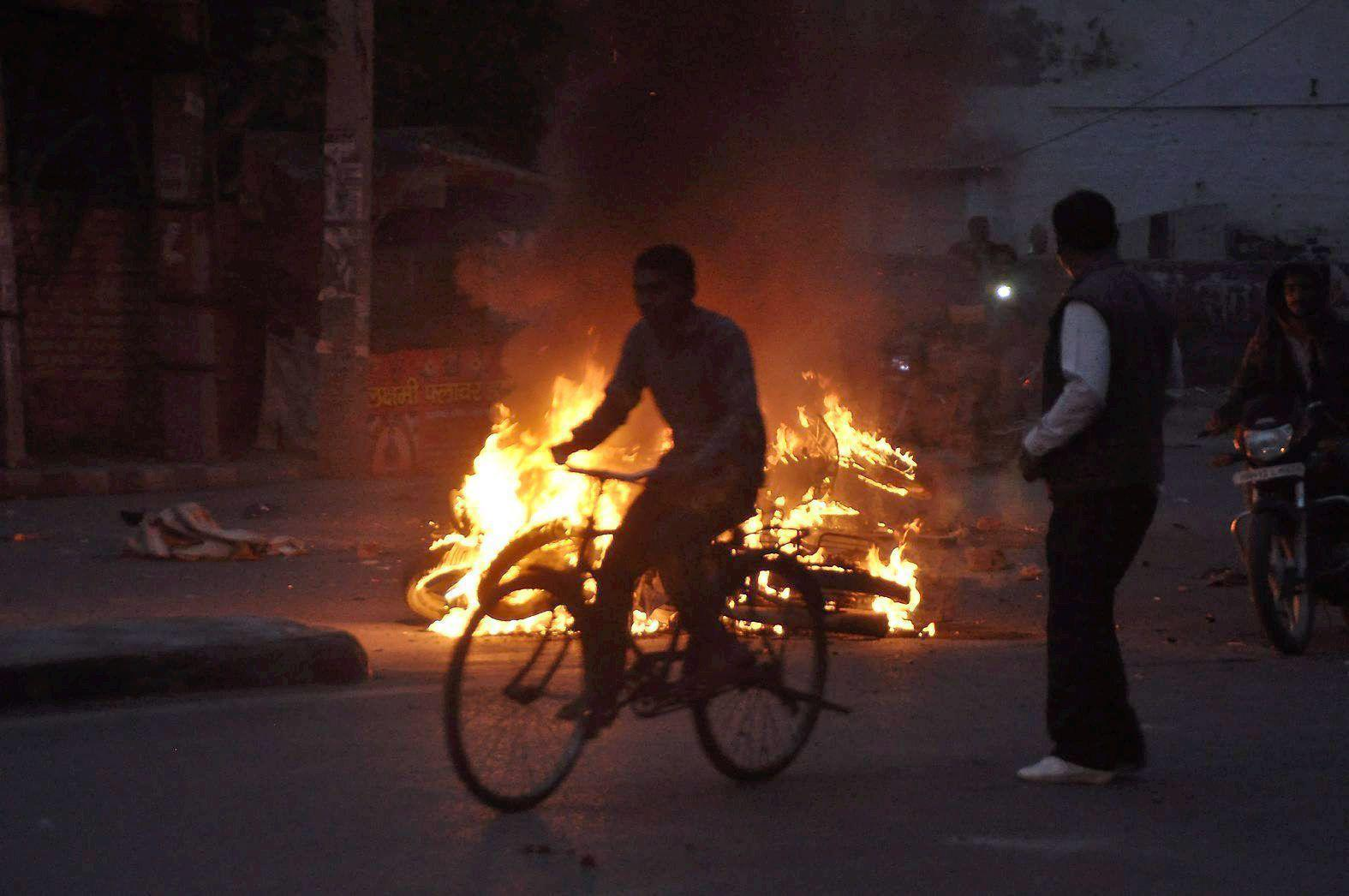 Rohtak:  Jat community members torch a motorcyle during their agitation for reservation in Rohtak on Thursday. PTI Photo   (PTI2_18_2016_000306A)