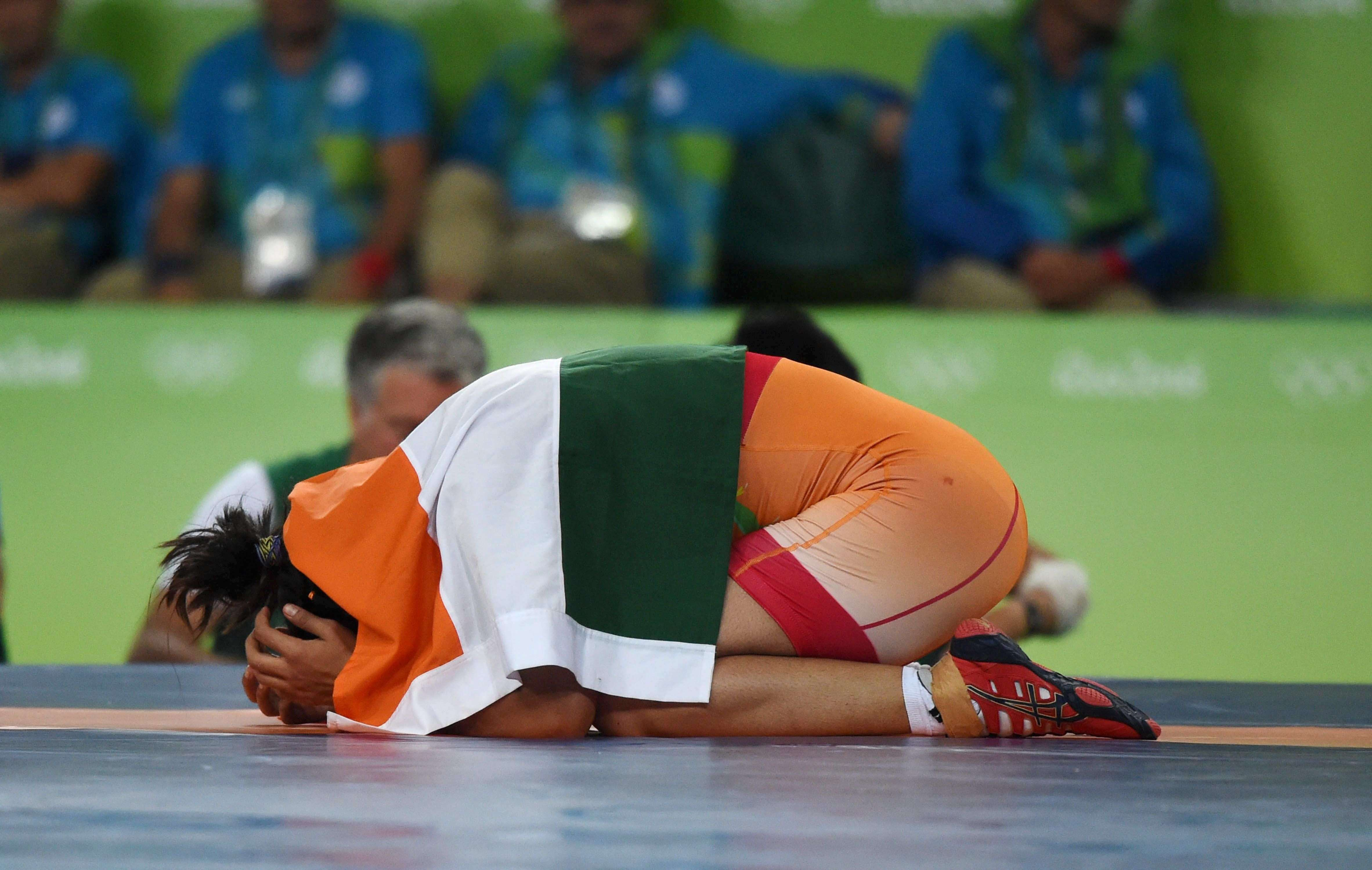 Rio de Janeiro: India's Sakshi Malik celebrates after winning bronze against Kyrgyzstan's Aisuluu Tynybekova in the women's wrestling freestyle 58-kg competition, at the 2016 Summer Olympics in Rio de Janeiro, Brazil on Wednesday. PTI Photo by Atul Yadav(PTI8_18_2016_000086B)