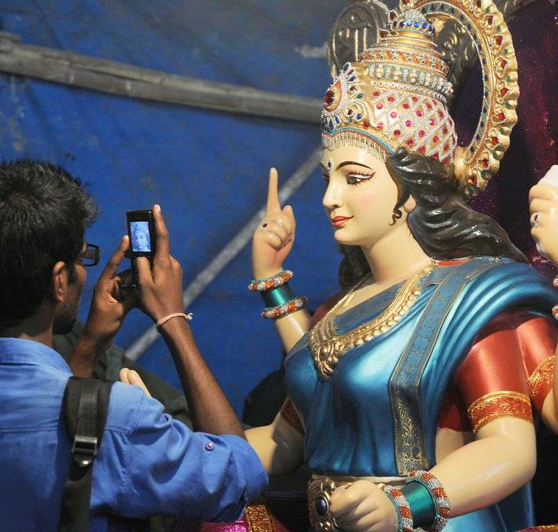 Youngsters taking picture from Mobiel in Vijay Kahtu workshop at Parel for the forth coming Navratri festival in Mumbai,The idols will be used during the Godess Amba Puja festival, a religious event to be held on 5 Oct 13 . Navarathri represents a celebration of the Goddess Amba, (the or Power). The Navarathri festival or 'Nine Nights festival' In Hindu mythology, Godess Amba symbolises power and the triumph of good over evil. Ashish Raje ,Mumbai Mirror 04 Oct 2013