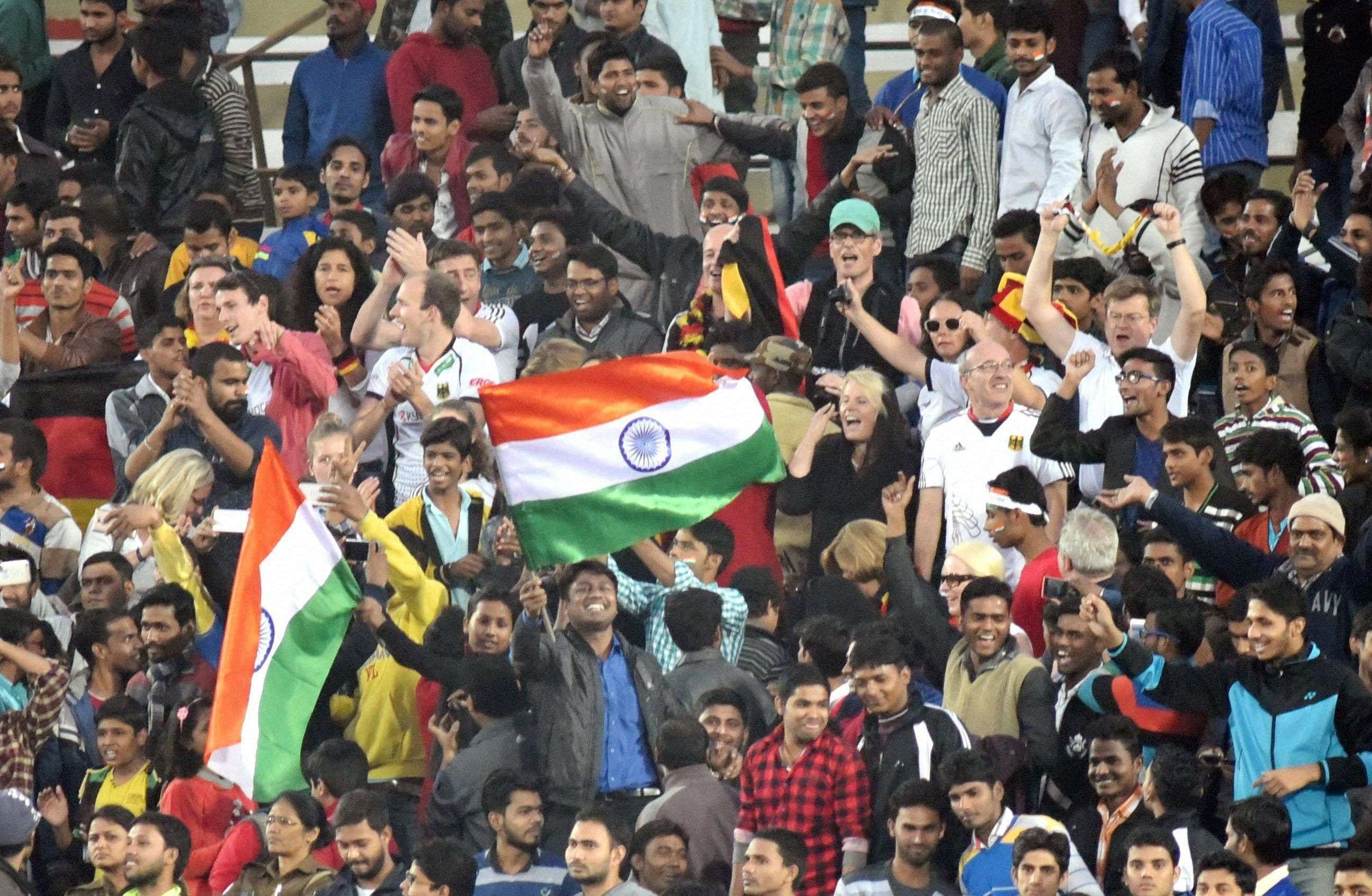 Lucknow: Spectators cheer during the Junior World Cup Hockey final match between Indian and Belgium in Lucknow on Sunday. PTI Photo (PTI12_18_2016_000169A)