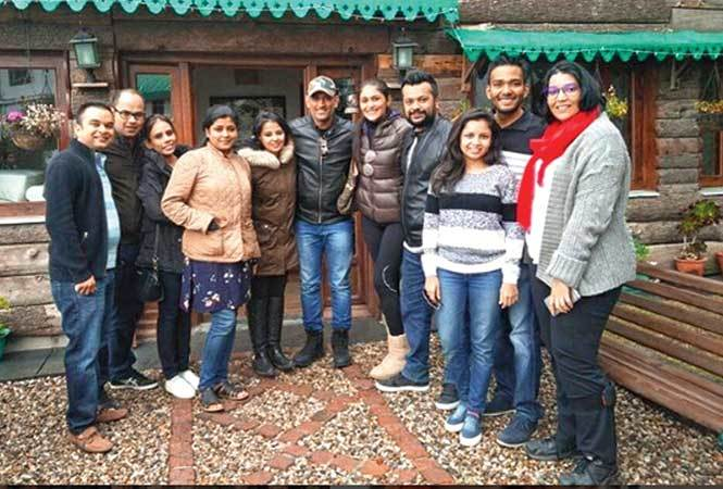 Dhoni and Sakshi with friends and family