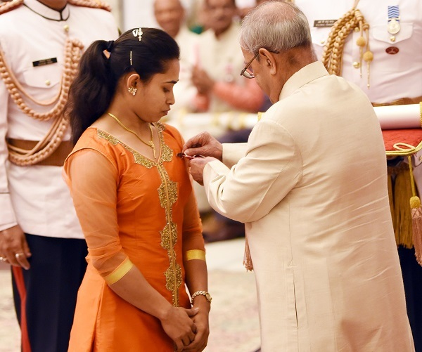 President Pranab Mukherjee confers the Padma Shri on Dipa Karmakar. Photo by Sanjay Sekhri