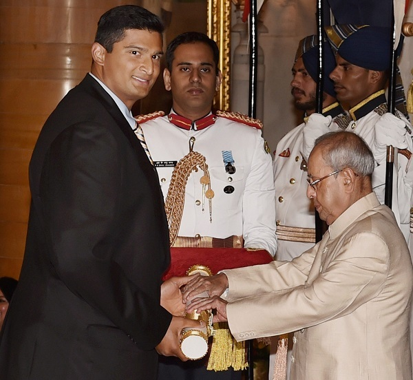 President Pranab Mukherjee confers the Padma Shri on Vikas Gowda. PTI