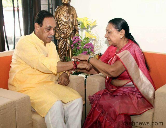 Former Gujarat CM Anandiben Patel ties a Rakhi to CM Vijay Rupani