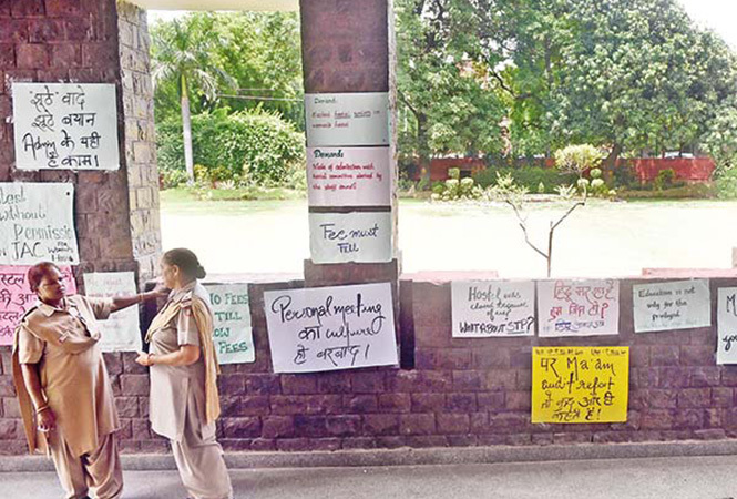 The posters put up on the walls of the college as part of the protest