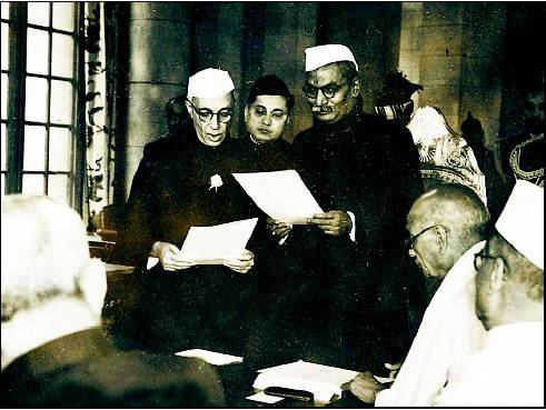 Nehru (extreme left) with the first President of independent India Rajendra Prasad (standing, extreme right)