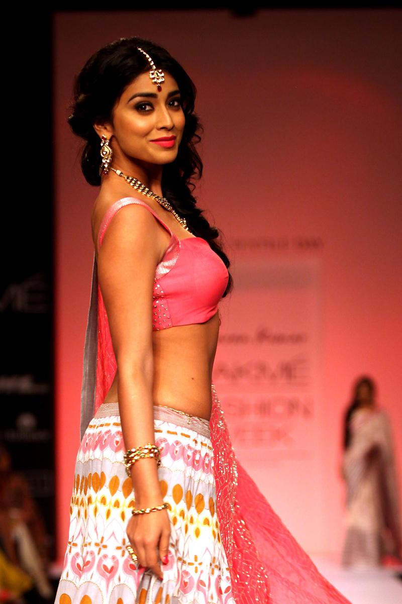 South Actress Hot Images: Shriya Saran walking the ramp in a candy coloured lehenga