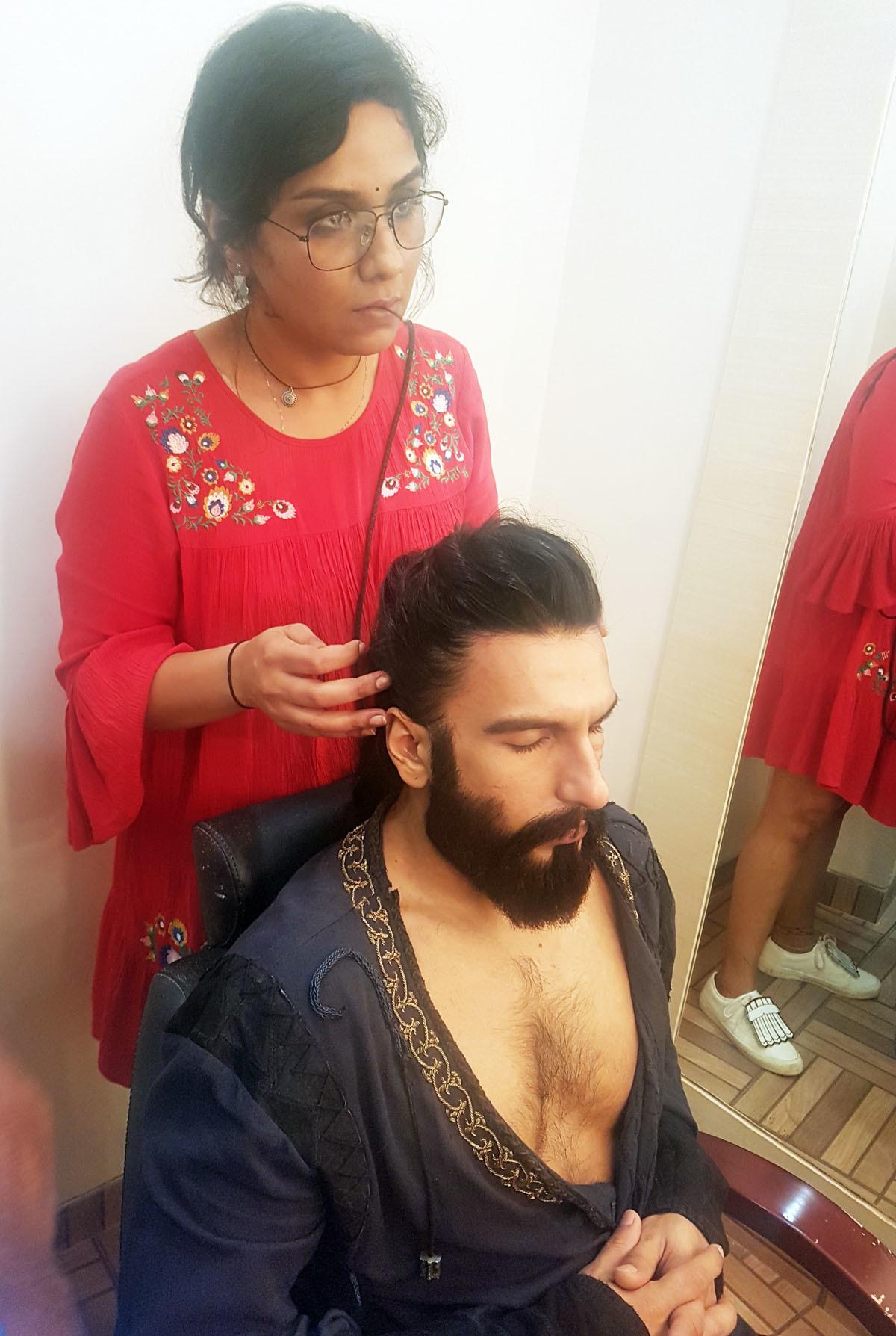Preetisheel Singh working on Ranveer Singh's look on the sets of Padmaavat. Pic 1.