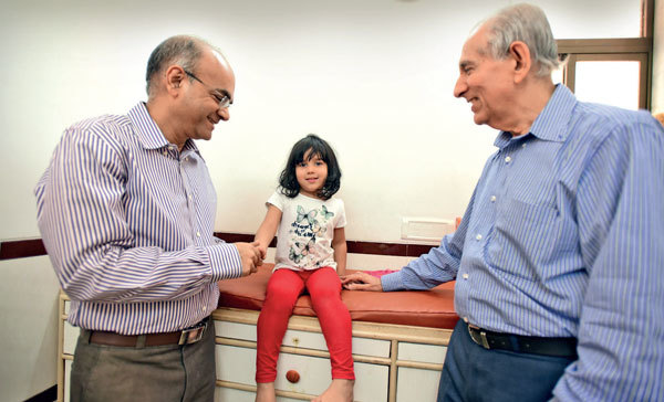 Dr Rajesh Chokhani (left) and Dr YK Amdekar with a patient (PICS: SATISH MALAVADE)