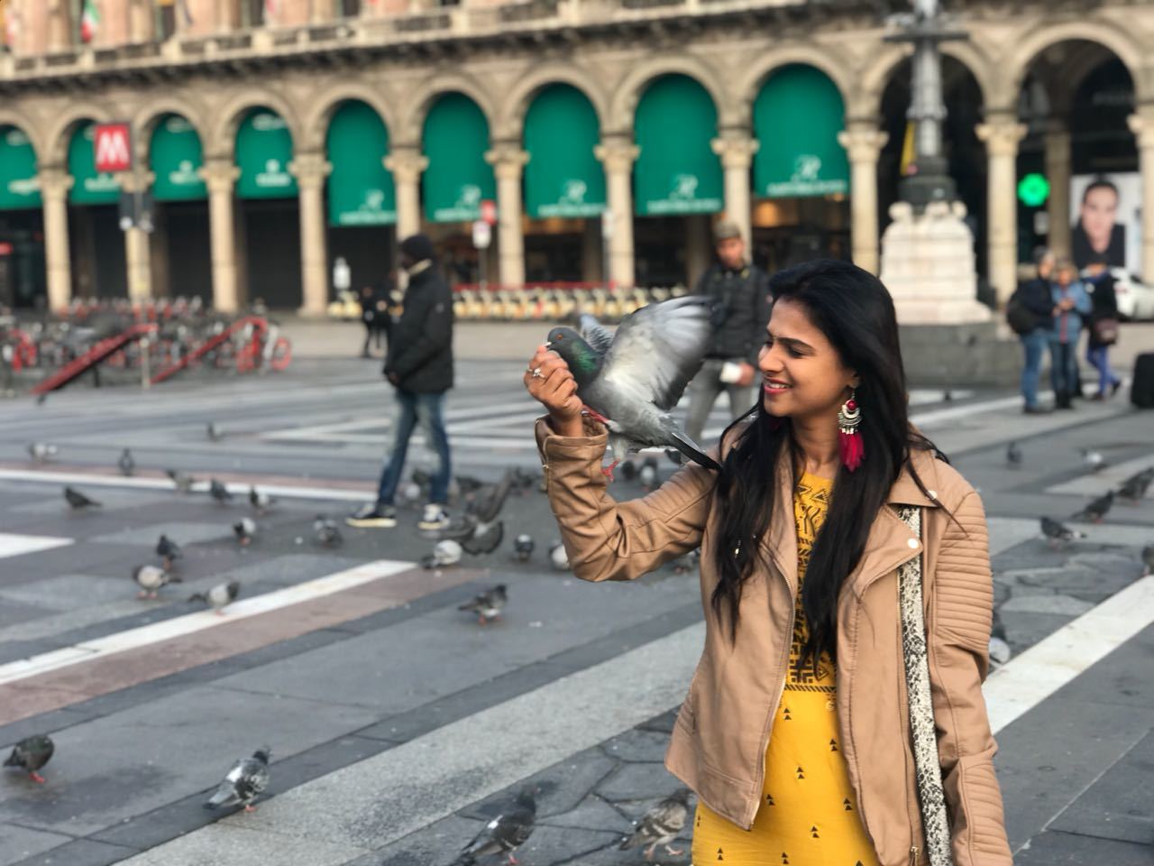 Kavitha Gowda with pigeons having a happy time