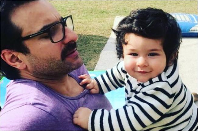 Taimur Ali Khan playing with dad pics