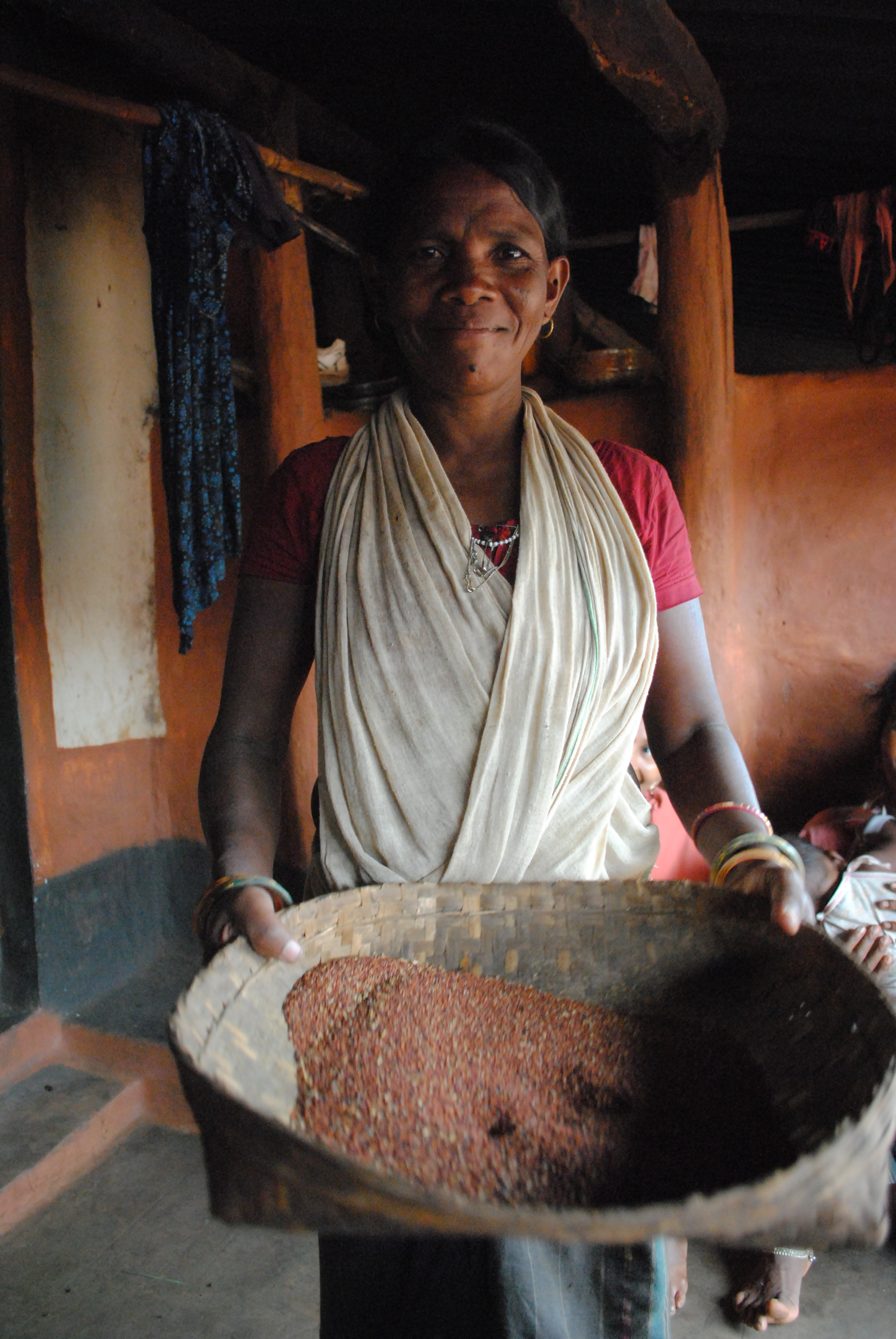 A tribal woman in Kandhamal's Burlubaru village showing millets she has grown in her forest farm (2)