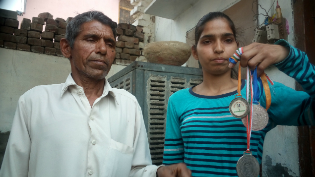Neha Jagra showing her medals