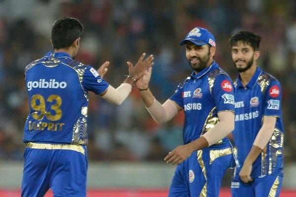 (l-r) Mumbai Indians cricketers Jasprit Bumrah, Rohit Sharma and Mayank Markande celebrate the wicket of Sunrisers Hyderabad player Yusuf Pathan. Photo: AFP