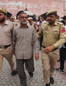 Sanji Ram being produced in District Court in Kathua on Monday. PTI