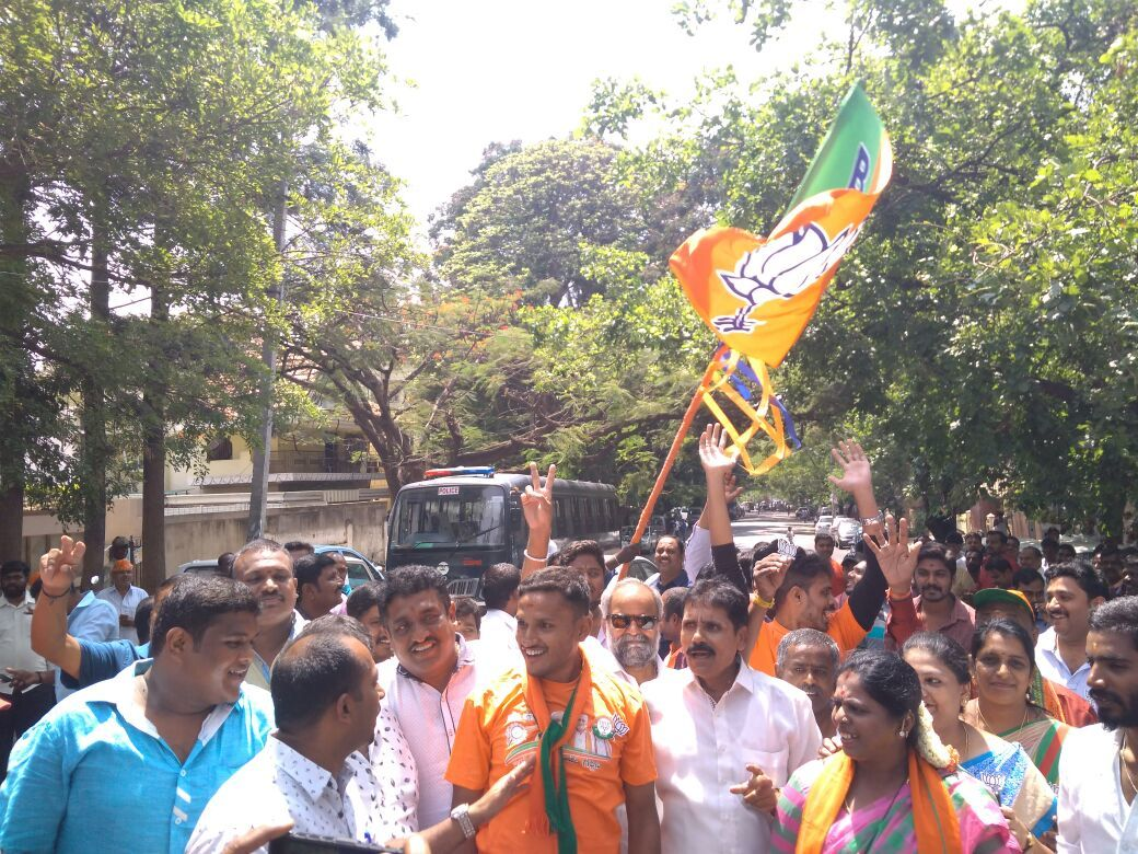 BJP supporters celebrate outside Jayanagar counting centre. Photo: S Eshwar