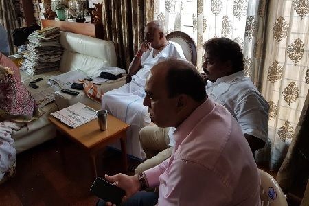 Deve Gowda watching results at home.