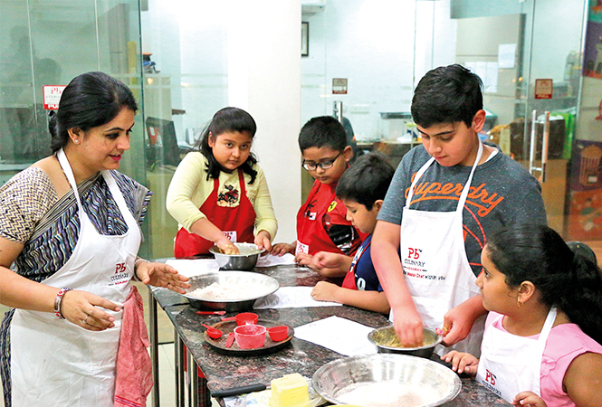 Kids learning new dishes at Pankaj Bhadouria's cookery class (BCCL/ Vishnu Jaiswal)