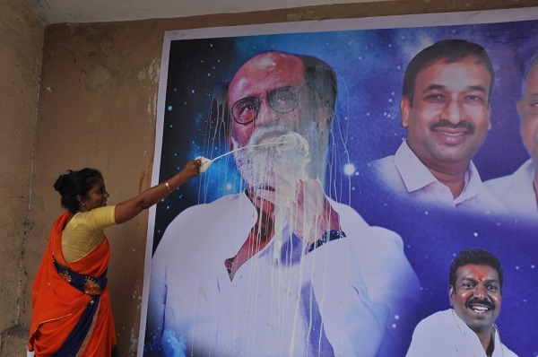 Fan in Chennai reveres a poster of Rajinikanth poster with milk in what is called paal abhishekam