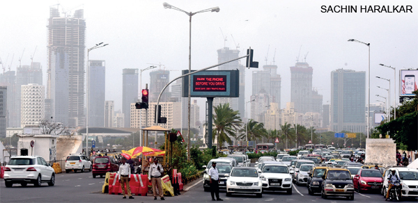 A traffic light equipped with area traffic control system at Haji Ali