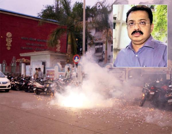 Kalyan-Dombivali residents celebrated Sanjay Gharat's (inset) arrest by bursting firecrackers