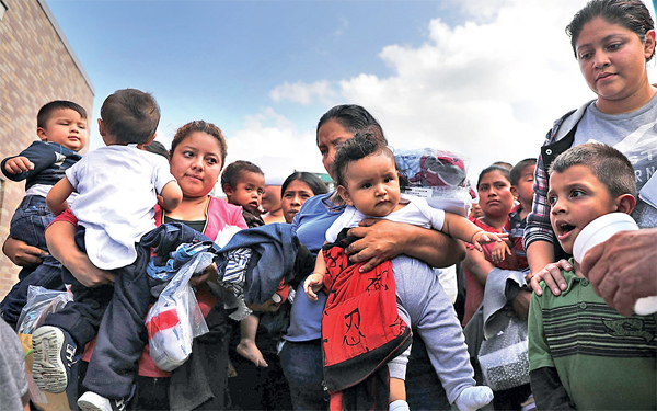 Women and children from Central American countries, released after being detained at the US border last week