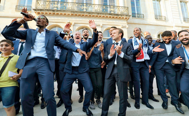 World Cup champions celebrate with French President Emmanuel Macron (centre) at the Elysee Presidential Palace. (Top left) Striker Kylian Mbappe