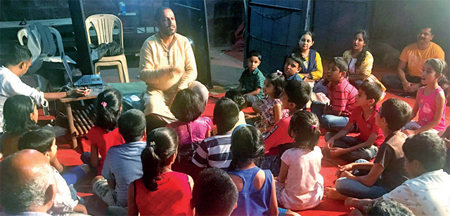 Sameer Dublay conducts a classical music class in Sindhudurg