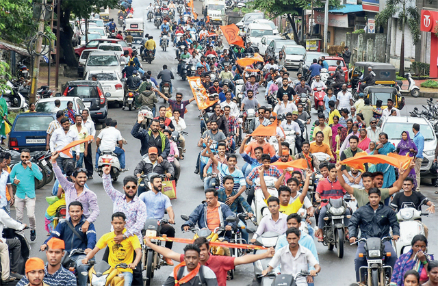 Maratha community members take part in a bike protest rally in Kolhapur