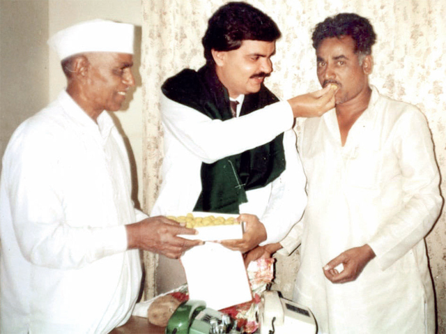 Vinode's father (right) and grandfather with Dr Vatwani (centre) at his nursing home in Borivali in 1991