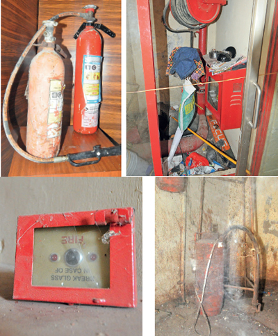 extinguishers were old and rusted while the hoses were non-functional & Disconnected fire alarm and decade-old fire extinguisher