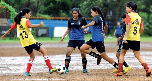Lakshadham striker Elizabeth Martin (second from left) scored twice in the Goregoan school's 2-0 win over Arya Vidyamandir (Bandra) at Azad Maidan, yesterday (PHOTO BY DEEPAK TURBHEKAR)