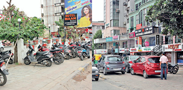 Two-and fourwheeler owners have encroached on footpaths along the ever-busy Jhansi Ki Rani Crossroads; Pics: Nilkanth Dave