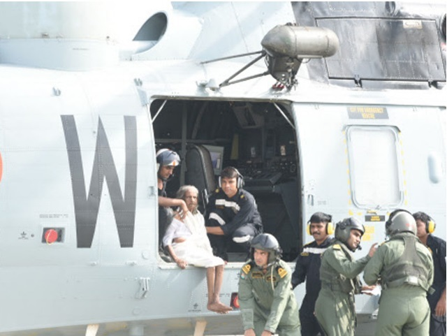 An old lady being evacuated through a helicopter landed at Naval airport in Kochi on Saturday. (TOI photo)