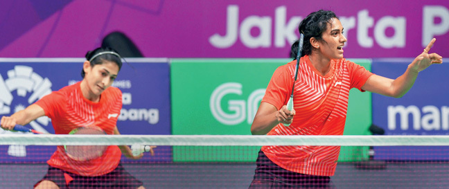 Ashwini Ponnappa (left) and PV Sindhu during yesterday's doubles match against Japan