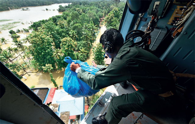 A soldier airdrops relief material in Chengannur on Sunday