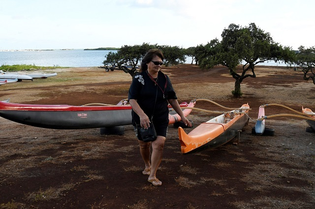 Lane Endo checks the canoes after moving them off the beach to higher ground as Hurricane Lane approaches Honolulu. Reuters Photos