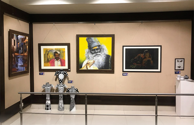 The exhibition features paintings by senior artists and art students