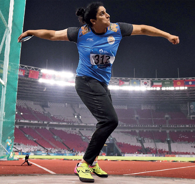 Seema Punia in action yesterday during her bronze medal-winning effort