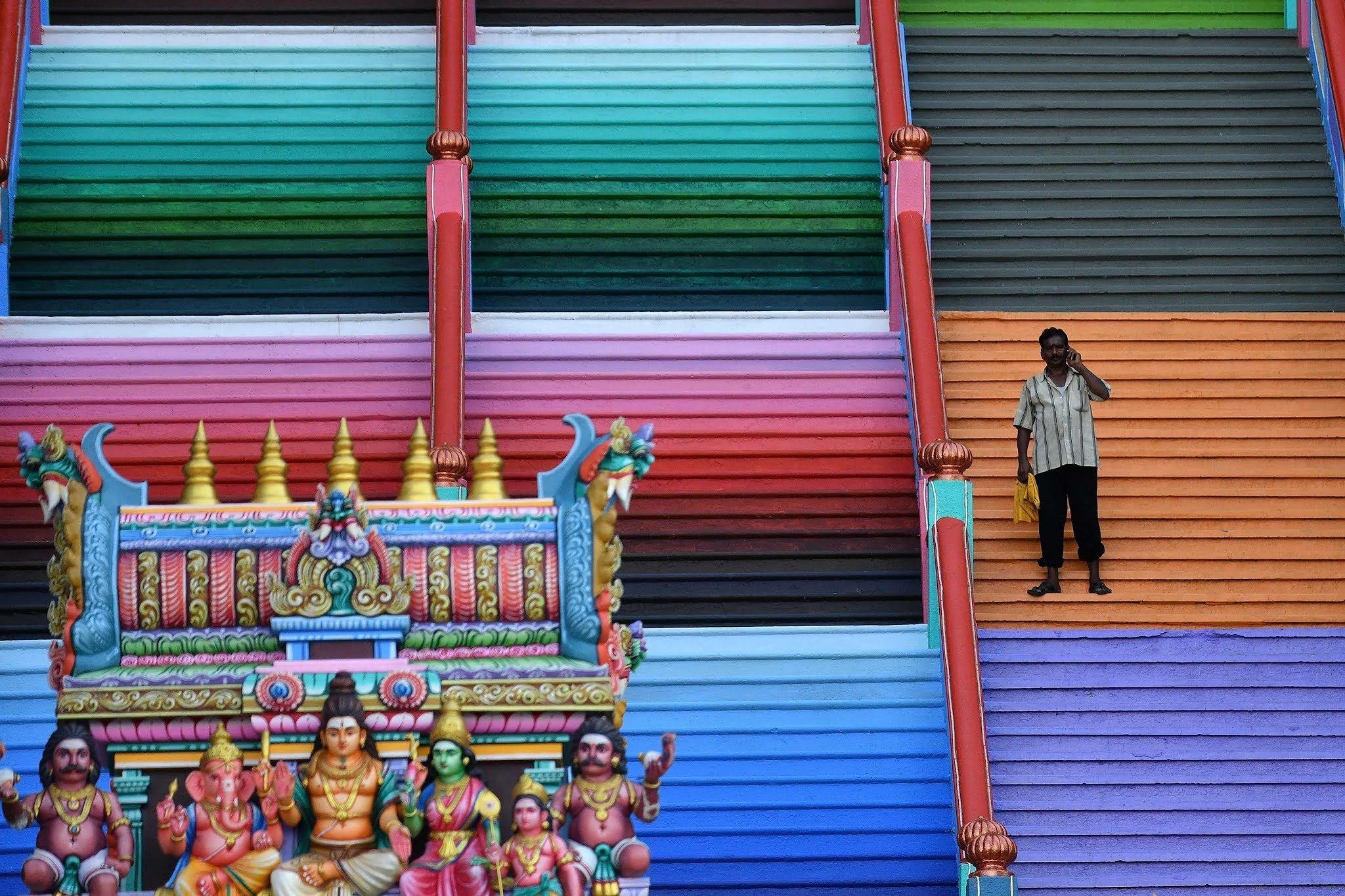 The steps to the temple complex was painted in a myriad of colours. (AFP)